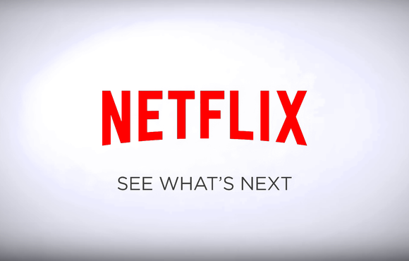 On a white field, a red Netflix logo with grey tagline: See what's next.