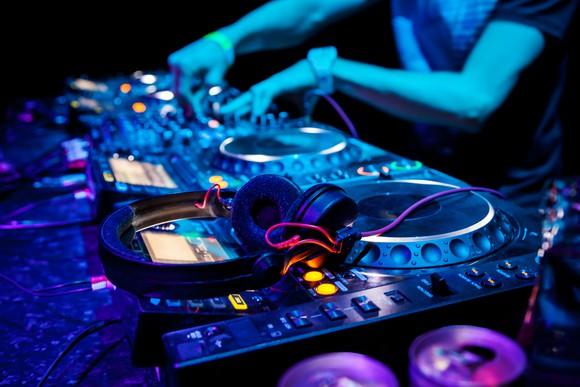 A DJ plays a dance track.