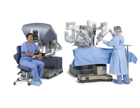 Two surgeons near a da Vinci system