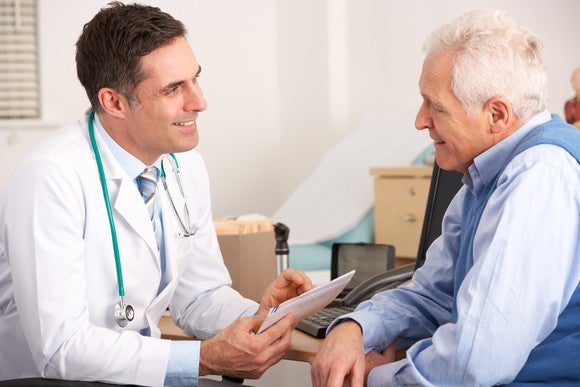 Doctor talking to a senior man