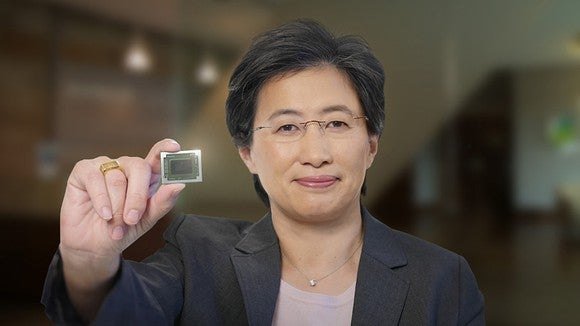AMD CEO Lisa Su holding a chip.