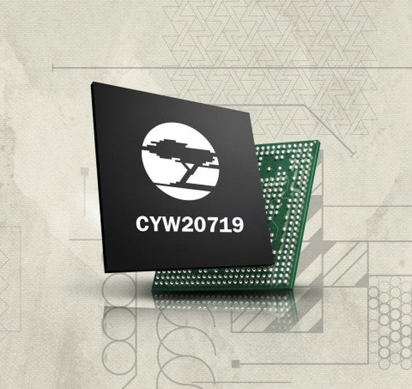 Cypress new bluetooth mesh chip, a small chip encased in a small black box with the company's logo of a cypress tree on the front.