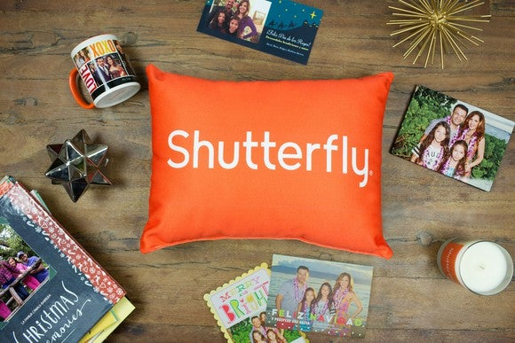 An assortment of photo-based mugs, prints, books, and pillows from Shutterfly.
