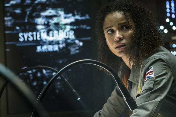 A still from the movie The Cloverfield Paradox, showing a female character with a look of fear and concern.