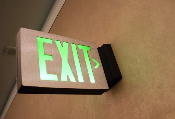 An emergency exit sign illuminated.