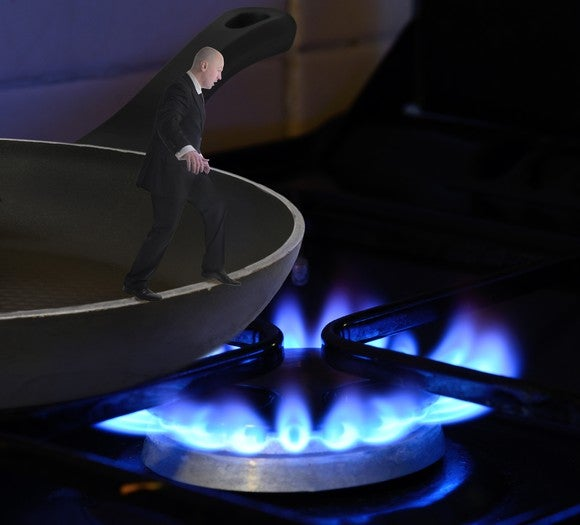 Miniature man stepping of the edge of a frying pan, into the fire.