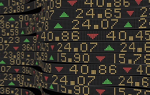 A stock market digital ticker showing prices rising and falling.