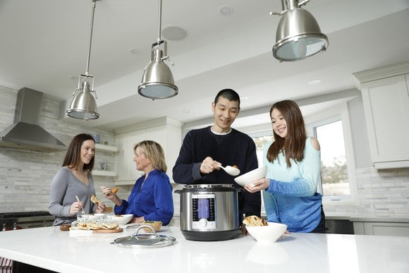 Family serving meal out of an Instant Pot