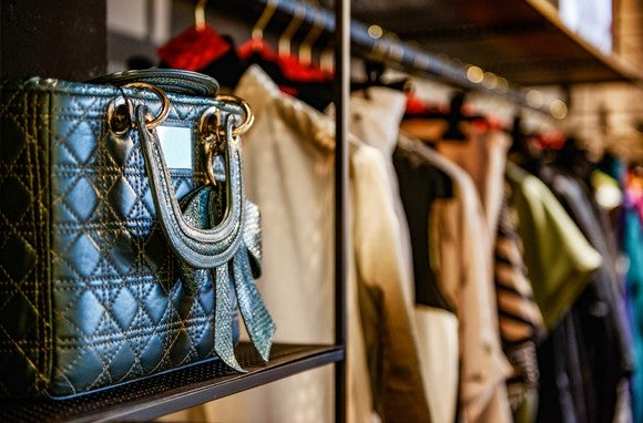 A purse on a shelf in a luxury consumer goods store.
