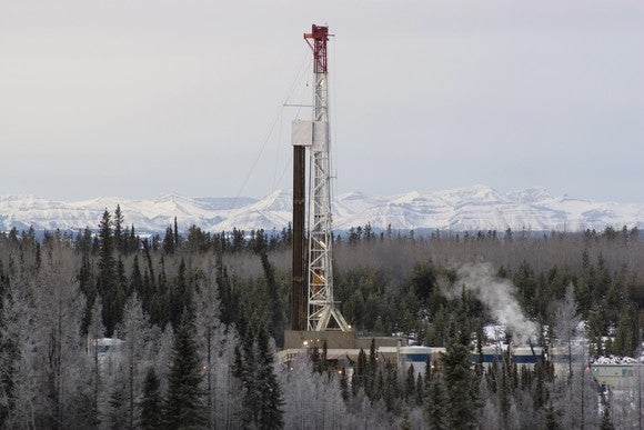 Drilling rig operating in forest during winter.