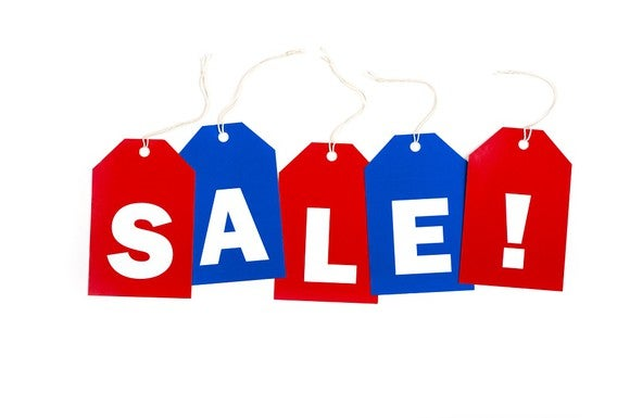 Red and blue price tags with individual letters lined up to spell SALE!