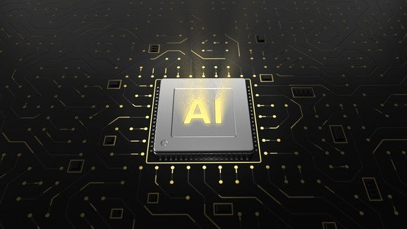 """A chip in a circuit board with the letters """"AI"""" on it."""