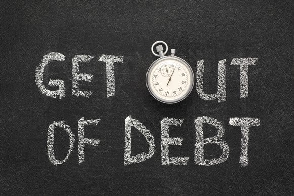 get out of debt written on a blackboard, with the o represented by a stopwatch