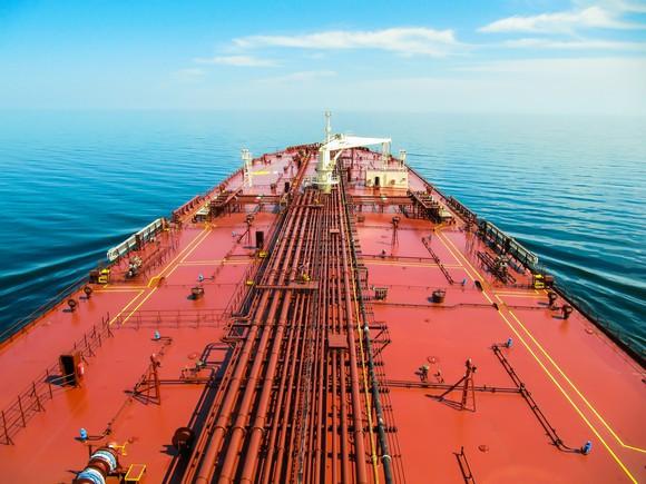A red-orange oil tanker deck on a blue ocean
