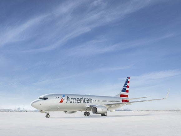 A rendering of an American Airlines jet on a tarmac with blue skies above