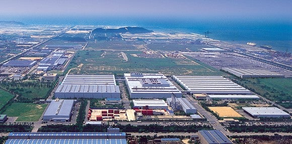 An aerial view of GM's Gunsan factory complex, including sevearl large buildings and a test track.