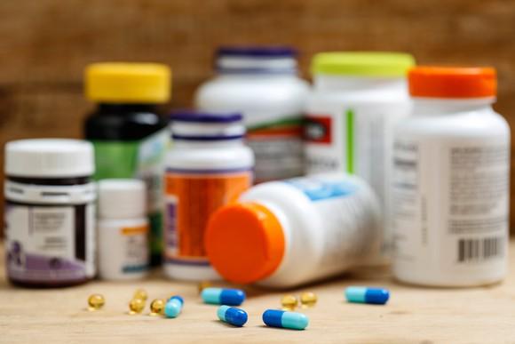 Scattered pill bottles and pills.