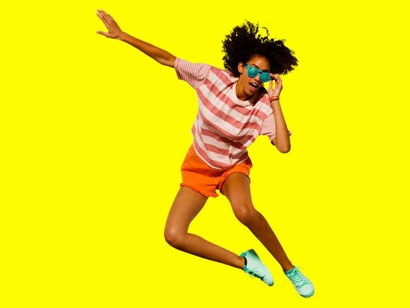 Girl wearing Snap's Spectacles in motion