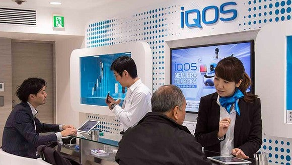 People in an iQOS store in Japan