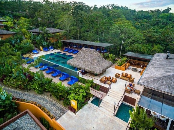 A resort in Costa Rica with a palapa and a pool