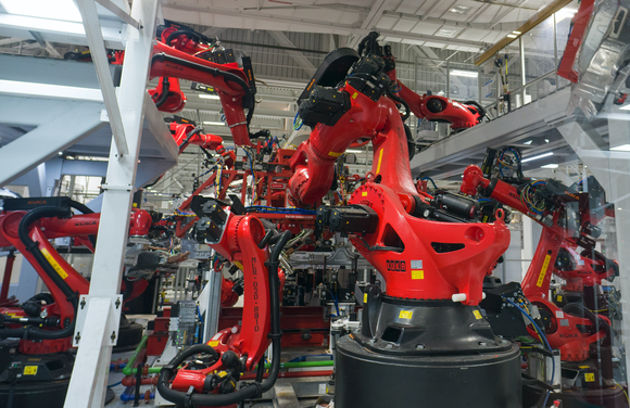 Robotic arms working in Tesla's vehicle factory