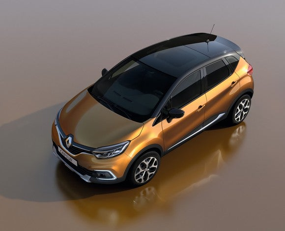 A bronze-and-black Renault Captur, a small SUV, viewed from above.