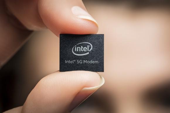 A person holding an Intel 5G modem.