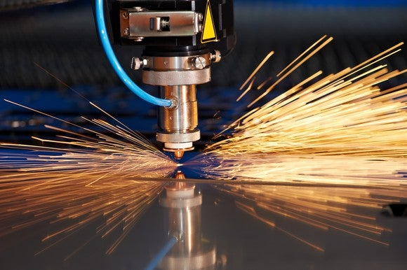 Laser drill in use with sparks flying.