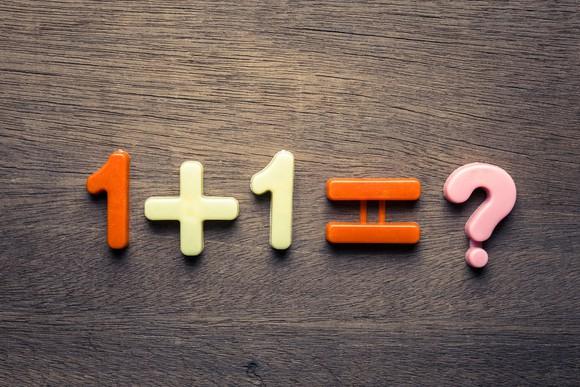 "Blocks displaying the equation ""1 + 1 = ?"""