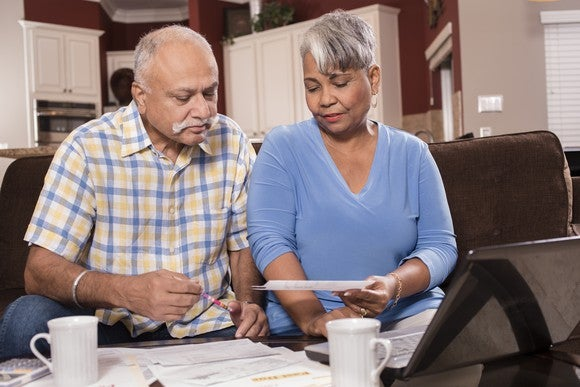 Older couple looking at documents