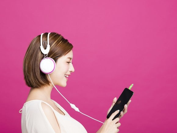 A woman listens to streaming music.