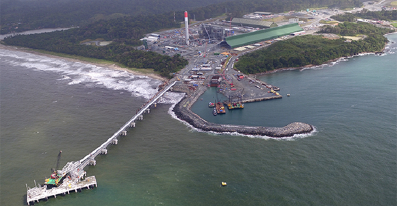 Overhead view of mining operation on coast extending offshore.