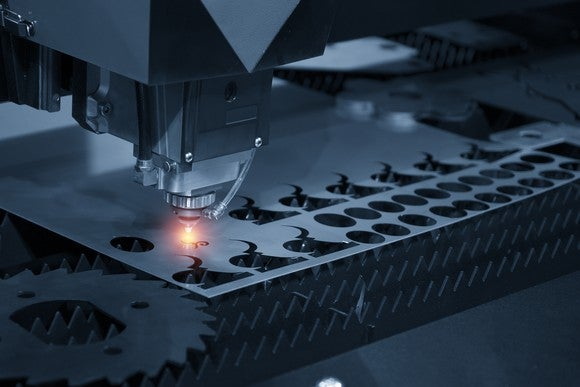 Laser system cutting shapes out of metal