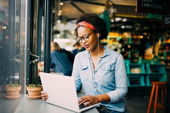 Woman types on laptop.