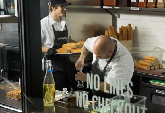 Cooks prepare food inside an Amazon Go store