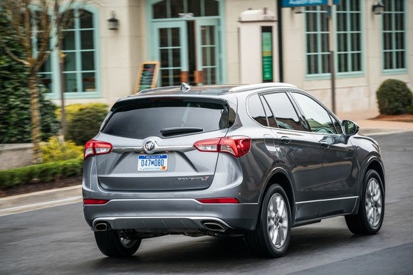 A silver 2019 Buick Envision SUV viewed from a rear three-quarter angle, showing the revamped taillights.