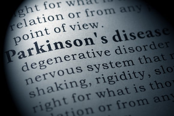 Definition of Parkinson's disease on paper as seen through a magnifying lens