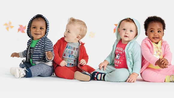 Four toddlers wearing Carter's clothing