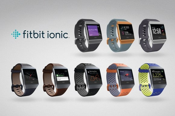 An advertisment featuring eight Fitbit Iconic smartwatches in different colors.