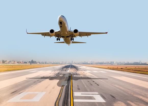 Plane taking off on runway