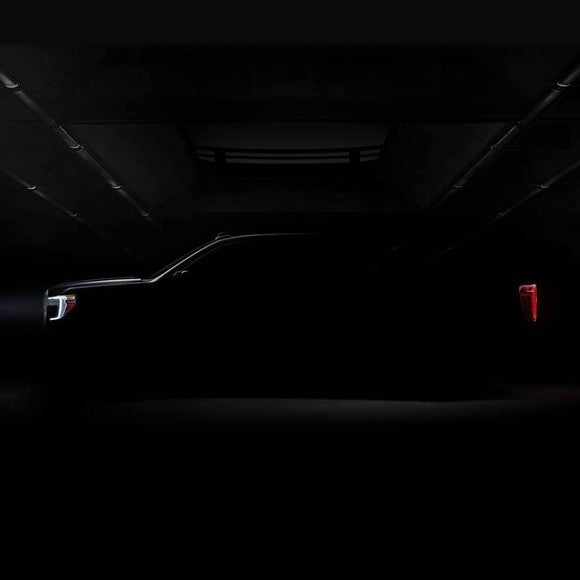 A darkened photo of the side of the 2019 GMC Sierra pickup. Only the truck's general outline is visible.