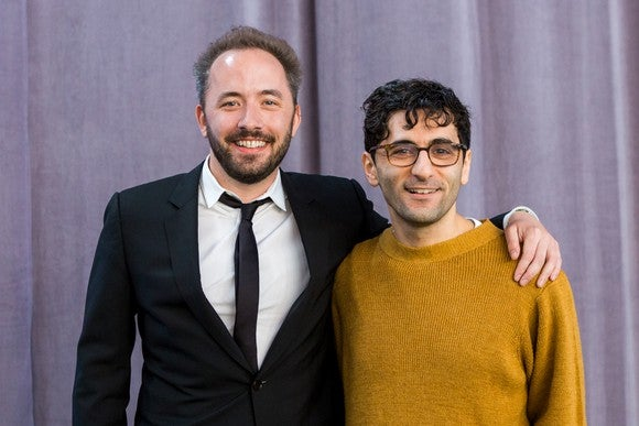 Drew Houston and Arash Ferdowsi standing together