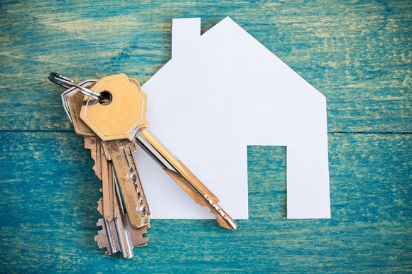 Keys on a paper cutout of a house
