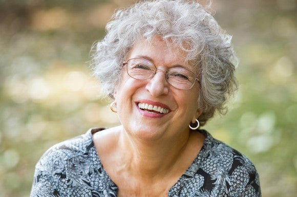 Smiling senior woman wearing glasses