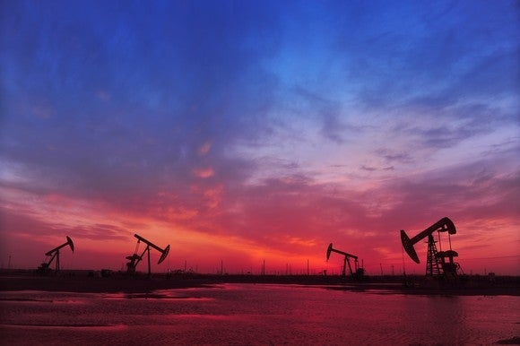 Oil pumps under a red and blue sky.