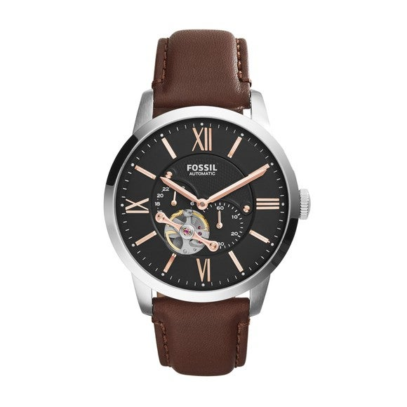 Fossil's Orologi Meccanici watch with a brown leather strap.