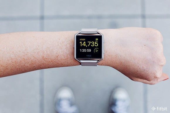 Fitness tracker on a wrist.