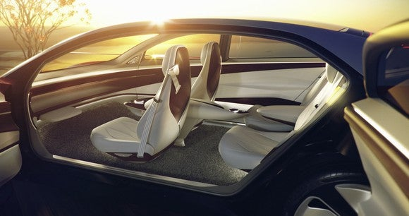 A look into the I.D. Vizzion concept car's interior, showing white seats and a smooth dashboard with no controls.