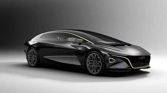 A dark gray Lagonda Vision Concept, a radically styled four-door sedan.