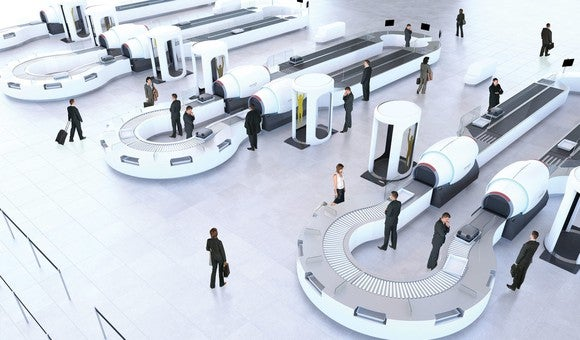 Three airport security screening stations with conveyors and scanning boths, with a few people in a mostly empty room.